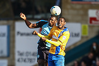Aaron Pierre of Wycombe Wanderers and Mani Dieseruvwe of Mansfield Town in an aerial battle during the Sky Bet League 2 match between Wycombe Wanderers and Mansfield Town at Adams Park, High Wycombe, England on 25 March 2016. Photo by David Horn.