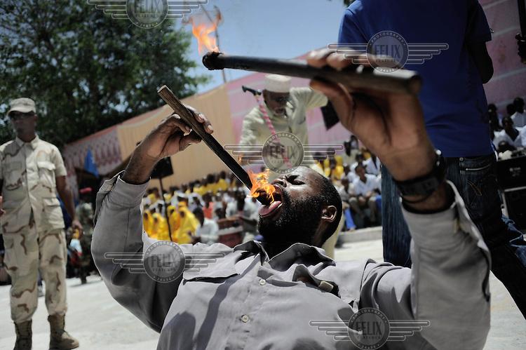 Mogadishu/Somalia 2012 - A man entertains during the music festival to honor the Mayor of Mogadishu.
