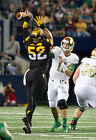 Arizona State Sun Devils defensive end Carl Bradford (52) tips Tommy Rees' pass in the first quarter.