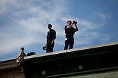 "Security on building roofs in Troy, Ohio scans the crowd during republican presidential candidate Mitt Romney campaign's ""Every Town Counts"" bus tour."