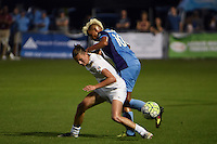 Kansas City, MO - Saturday May 28, 2016: Orlando Pride midfielder Lianne Sanderson (10) defends against FC Kansas City midfielder Mandy Laddish (7) during a regular season National Women's Soccer League (NWSL) match at Swope Soccer Village.  Kansas City won 2-0.