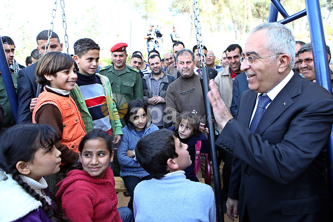 Palestinian Prime Minister Salam Fayyad, waves to the children during the opening of the vocational rehabilitation centre for the Deaf in Village of Nabi Elias, in the West Bank city of Qalqilya on March 3, 2011. Photo by Mustafa Abu Dayeh