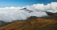 It is not unusual for clouds to engulf the crater at HALEAKALA NATIONAL PARK on Maui in Hawaii