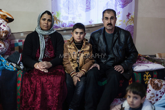 07/02/15 -- Sulaimaniyah, Iraq -- Abu Dilshad and his family in their room at the Baghdad Hotel. Abu Dilshad arrived from Shingal with his wife, his two boys and older members of the family, including his father and mother. He works at the reception of the hotel.