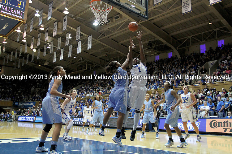 03 March 2013: Duke's Elizabeth Williams (1) shoots over North Carolina's Xylina McDaniel (34). The Duke University Blue Devils played the University of North Carolina Tar Heels at Cameron Indoor Stadium in Durham, North Carolina in a 2012-2013 NCAA Division I and Atlantic Coast Conference women's college basketball game. Duke won the game 65-58.