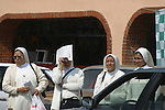 FOUR NUNS WAITING FOR RIDE ON MEXICAN STREET(3)