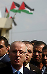 Palestinian Prime Minister Rami Hamdallah speaks to media upon his arrival to the Beit Hanoun in the northern Gaza Strip on October 9, 2014. The Palestinian unity government which took the oath of office in June under technocrat prime minister Rami Hamdallah arrived to Gaza Strip on Thursday to convene the first fully meeting. Hamdallah said that the unity government will rebuild the bombed-out Gaza Strip following a seven-week Israeli offensive. Photo by Abed Rahim Khatib