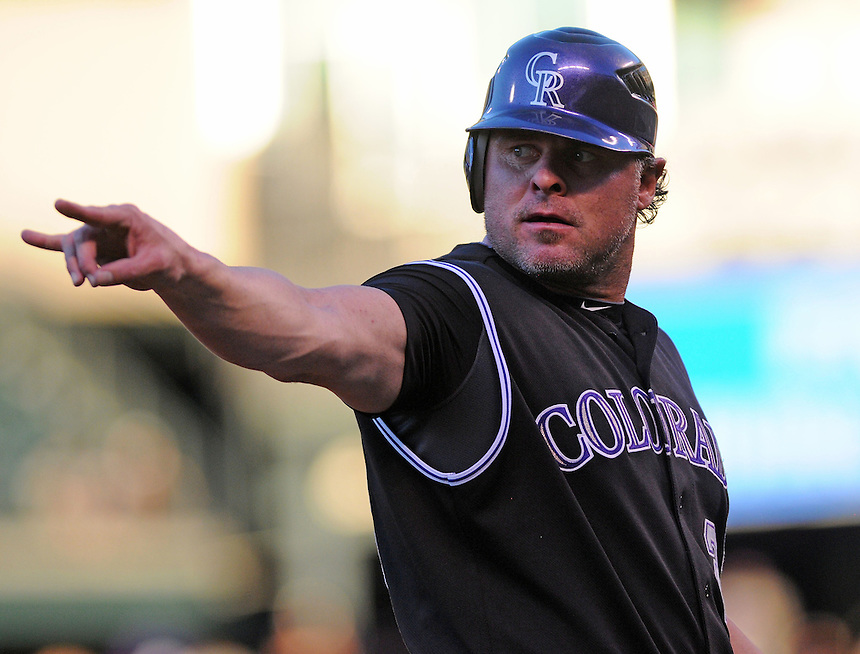 15 AUGUST 2011: Colorado Rockies first baseman Jason Giambi (23) confirms that there are two outs as he stands at third base    during a regular season game between the Florida Marlins and the Colorado Rockies at Coors Field in Denver, Colorado. The Rockies beat the Marlins 7-4. *****For Editorial Use Only*****