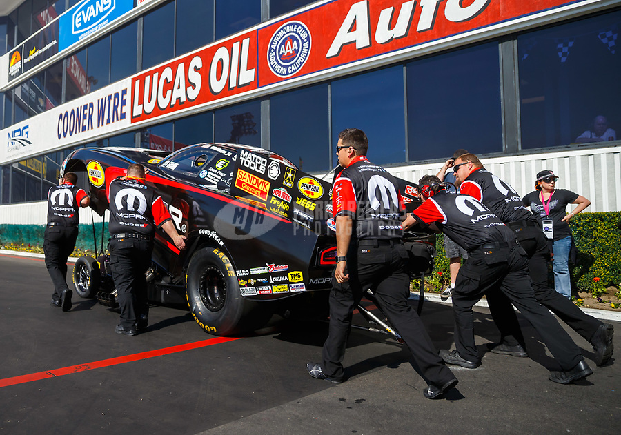 Feb 9, 2018; Pomona, CA, USA; Crew members push NHRA funny car driver Matt Hagan during qualifying for the Winternationals at Auto Club Raceway at Pomona. Mandatory Credit: Mark J. Rebilas-USA TODAY Sports