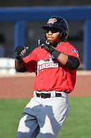 Frisco Rough Riders outfielder Chris Grayson (36) touches home after hitting a home run during the first game of a doubleheader against the Tulsa Drillers on May 29, 2014 at ONEOK Field in Tulsa, Oklahoma.  Frisco defeated Tulsa 13-4.  (Mike Janes/Four Seam Images)