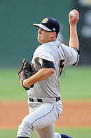 Pitcher Matt Marsh (15) of the Charleston RiverDogs delivers a pitch in a game against the Greenville Drive on Monday, June 29, 2015, at Fluor Field at the West End in Greenville, South Carolina. Greenville won, 4-2. (Tom Priddy/Four Seam Images)