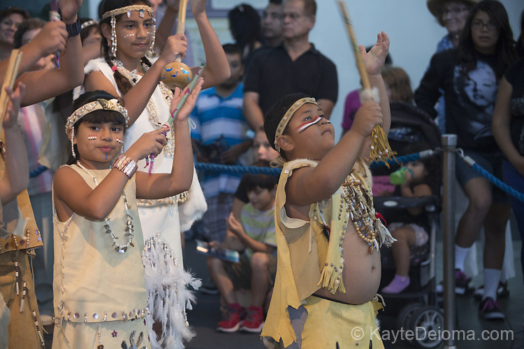 The Tongva Nation Dancers perform at the Moompetam Gathering of Coastal Tribes at the Aquarium of the Pacific in Long Beach, CA