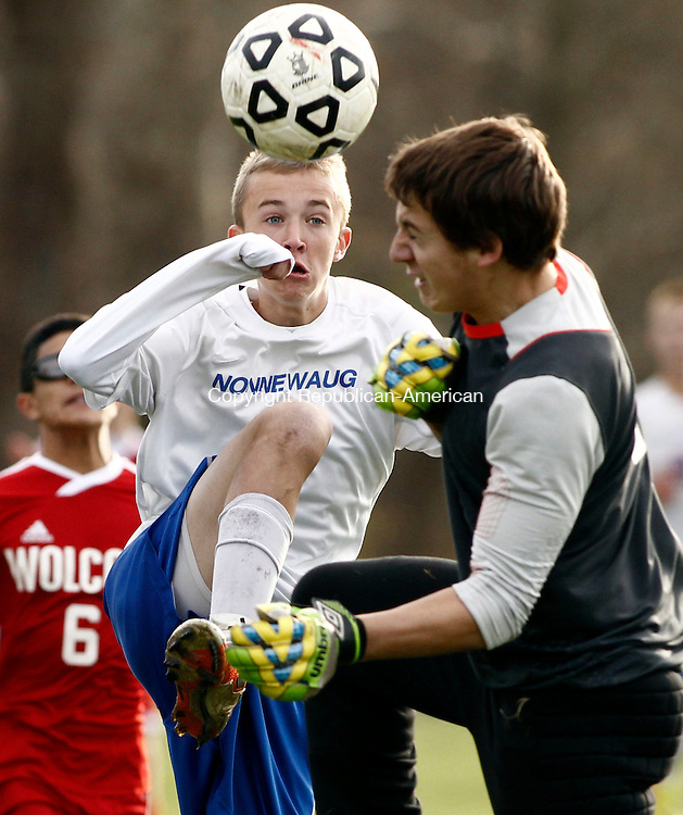 Woodbury, CT- 03 November 2013-110513CM06- Nonnewaug's Nathan Firlings, left, takes the ball around Wolcott goalie, Matthew Carnein, for a score during Class M boys soccer action Tuesday afternoon in Woodbury.  Nonnewaug won, 3-0.      Christopher Massa Republican-American