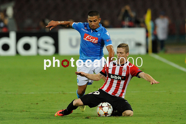Walter Gargano of Napoli and Iker Muniain of Athletic during the match between SSC Napoli and Athletic Club Bilbao, play-offs First leg Champions League at the San Paolo Stadium onTuesday August 19, 2014 in Napoli, Italy. (Photo by Marco Iorio)<br />