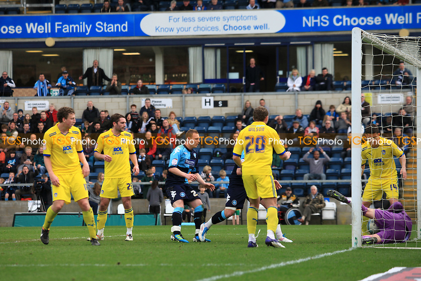 Colchester goalkeeper, Ben Williams, makes a fine save from a Gary Doherty header - Wycombe Wanderers vs Colchester United - nPower League One Football at Adams Park, High Wycombe - 10/03/12 - MANDATORY CREDIT: Paul Dennis/TGSPHOTO - Self billing applies where appropriate - 0845 094 6026 - contact@tgsphoto.co.uk - NO UNPAID USE.
