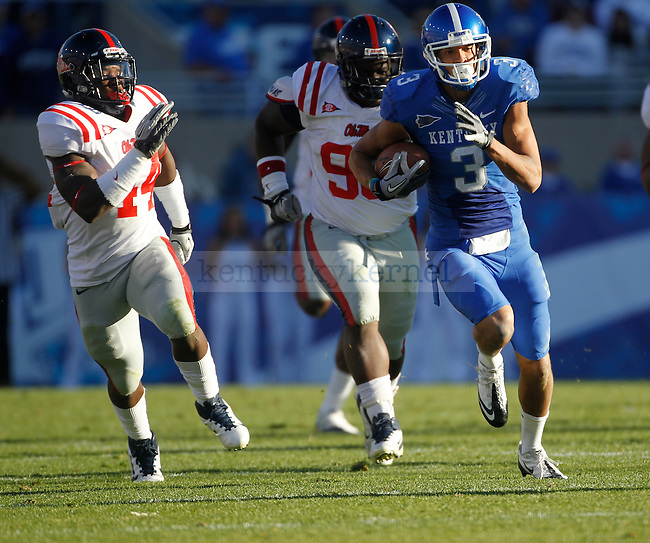 Kentucky Wildcats wide receiver Matt Roark (3) runs with the ball during the first half of the University of Kentucky football game against Ole Miss at Commonwealth Stadium in Lexington, Ky., on 11/5/11. Roark had 116 total receiving yards. Uk led at half 10-6. Photo by Mike Weaver | Staff