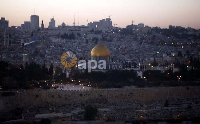A general photo shows the Dome of the Rock mosque during the sunset  on the last day of the year on December 31, 2012. Photo by Mahfouz Abu Turk