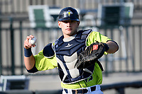 Catcher Hayden Senger (15) of the Columbia Fireflies warms up before a game against the Augusta GreenJackets on Thursday, July 11, 2019 at Segra Park in Columbia, South Carolina. Columbia won, 5-2. (Tom Priddy/Four Seam Images)