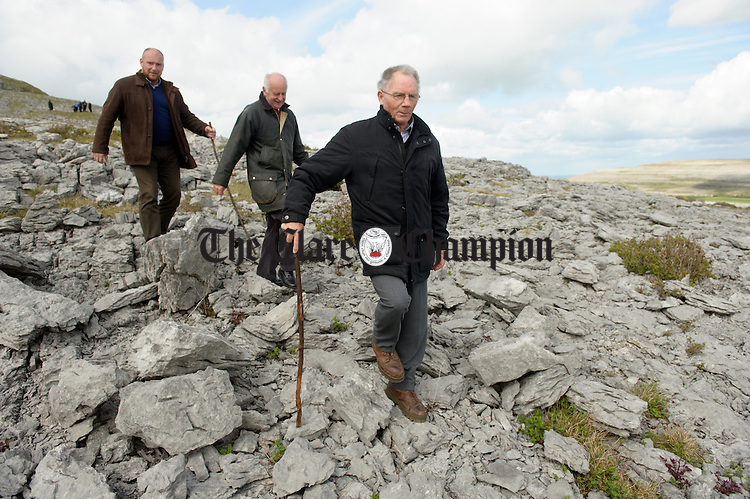 Oliver Nagle, Landowner, Michael Davoren, Burren IFA, and Pat Nagle, Landowner, head down to the field entrance to welcome Charles Prince of Wales, during his visit to the Burren in County Clare as part of his four day trip to Ireland. Photograph by John Kelly.