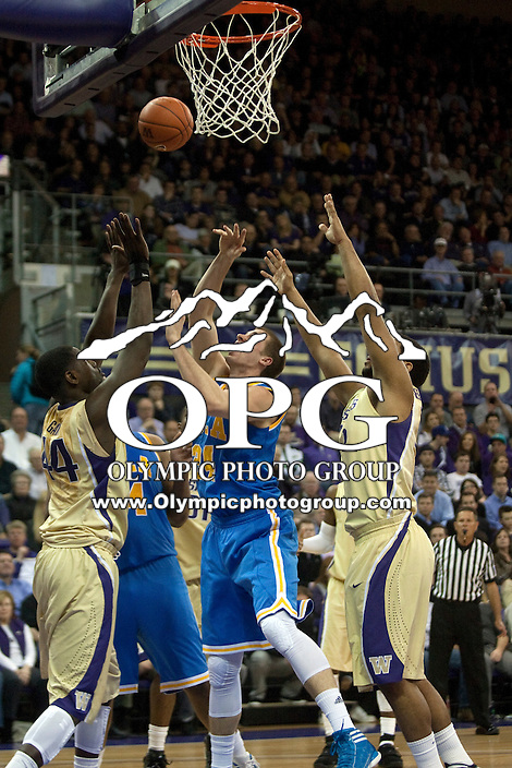 Feb 2, 2012:  UCLA's #24 Travis Wear throws the ball up in traffic against Washington.  Washington defeated UCLA 71-69 at Alaska Airlines Arena Seattle, Washington...