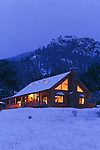 A warm and inviting log home in the Rocky Mountains of Colorado during the winter