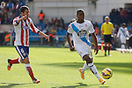 Atletico de Madrid´s Koke (L) and Deportivo de la Coruña´s Cavalaiero during 2014-15 La Liga match between Atletico de Madrid and Deportivo de la Coruña at Vicente Calderon stadium in Madrid, Spain. November 30, 2014. (ALTERPHOTOS/Victor Blanco)