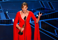 """Allison Janney accepts the award for best performance by an actress in a supporting role for """"I, Tonya"""" at the Oscars on Sunday, March 4, 2018, at the Dolby Theatre in Los Angeles. (Photo by Chris Pizzello/Invision/AP)"""
