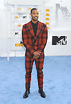 LOS ANGELES, CA - APRIL 12: Actor Michael B. Jordan arrives at the 2015 MTV Movie Awards at Nokia Theatre L.A. Live on April 12, 2015 in Los Angeles, California.