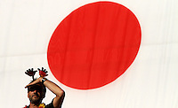 Wolfsburg , 100711 , FIFA / Frauen Weltmeisterschaft 2011 / Womens Worldcup 2011 , Viertelfinale ,  Deutschland (GER) - Japan (JPN) .deutscher Fan vor japanischer Flagge .Foto:Karina Hessland .