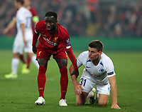 5th November 2019; Anfield, Liverpool, Merseyside, England; UEFA Champions League Football, Liverpool versus Genk; Naby Keita of Liverpool helps Joakim Maehle of KRC Genkto his feet after they collide - Editorial Use