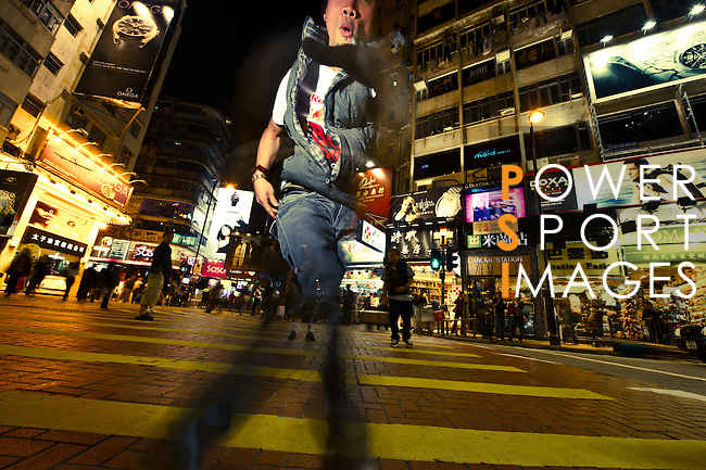 B-Boy Ronnie performing on the streets of Hong Kong's Causeway Bay district.