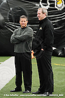 October 12, 2009; Hamilton, ON, CAN; Hamilton Tiger-Cats head coach Marcel Bellefeuille and president Scott Mitchell chat before the game. CFL football: Winnipeg Blue Bombers vs. Hamilton Tiger-Cats at Ivor Wynne Stadium. The Blue Bombers defeated the Tiger-Cats 38-28. Mandatory Credit: Ron Scheffler. Copyright (c) 2009 Ron Scheffler.