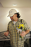 Daren Adkisson, 39, of Rock Island, Illinois stands after being given a bouquet to congratulate him on his forthcoming marriage to Curtis Harris, 50, at the Scott County Recorder's Office the first day same sex weddings are legal across Iowa in Davenport, Iowa on April 27, 2009.  Adkisson traveled with Harris first thing across the river to Iowa to get a marriage license.