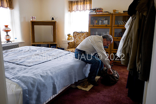 Selllersville, Pennsylvania<br /> April 2, 2011<br /> <br /> Sorting through his one suitcase of belongings and a few clothes hang on the wall, 99er Steve Nathan, a 51 year old paralegal, was evicted from his home of 11 years in November 2010 and lost his benefits in late 2010. He now lives in one room of a friend's home. His landlords are Darwin Roseberry and Barbara Wise a 70 year old married couple who live on a farm and practice law.