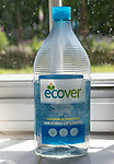 Plastic container bottle of Ecover environmentally friendly washing-up liquid on kitchen window, England, UK