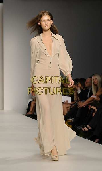 MODEL.At the Ossie Clark fashion show during London Fashion Week, BFC Tent,  London, England, September 14th 2008..modelling catwalk runway spring summer collection 09 full length cream beige shirt  long maxi dress.CAP/CAN.©Can Nguyen/Capital Pictures