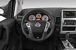 Car pictures of steering wheel view of a 2014 Nissan Titan PRO 4-X King Cab 2WD 2 Door Truck Steering Wheel