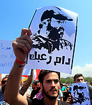 Lebanese take part in a protest the visit by Gen. Frank McKenzie, the head of U.S. Central Command, outside ​​the Rafik Hariri International Airport in Beirut, Lebanon, July 8, 2020. Photo by Haitham Al-Mousawi