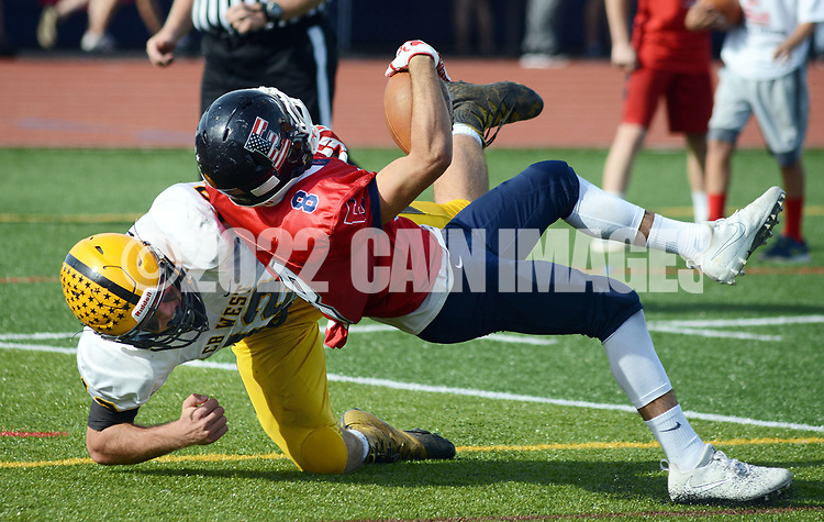 Central Bucks East's Chris Lochetta (8) is stopped short of the end zone by Central Bucks West's Jack Neri (12) in the third quarter Saturday, October 21, 2017 at Central Bucks East in Buckingham, Pennsylvania. (WILLIAM THOMAS CAIN / For The Philadelphia Inquirer)