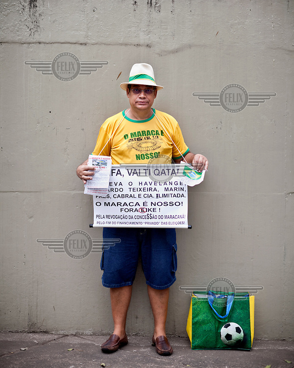 A protestor holds a placard decrying the costs of hosting the 2014 FIFA World Cup. A huge demonstration by Cariocas (residents of Rio de Janeiro), estimated to be 300,000 strong, took place in the city centre. Countrywide protests originally broke out in response to an increase in public transport fares and although the government made a U-turn over the fare rise protests continued as people expressed their frustration over a number of issues, including heavy-handed policing, poor public services and the high costs for hosting the 2014 FIFA World Cup and its precursor the Confederation's Cup.