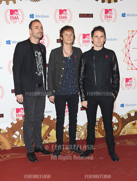 Chris Wolstenholme, Dominic Howard and Matthew Bellamy of Muse arriving for the The MTV EMA's 2012 held at Festhalle, Frankfurt, Germany. 11/11/2012 Picture by: Henry Harris / Featureflash