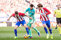 Saul Iniguez and Antoine Griezmann of Atletico de Madrid competes for the ball with Leo Messi of Futbol Club Barcelona  during the match of Spanish La Liga between Atletico de Madrid and Futbol Club Barcelona at Vicente Calderon Stadium in Madrid, Spain. February 26, 2017. (ALTERPHOTOS) /NortEPhoto.com