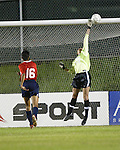 Venus James' (16) shot beats Aly Winget, but not the crossbar, at SAS Stadium in Cary, North Carolina on 3/22/03 during a game between the Carolina Courage and University of North Carolina Tarheels.