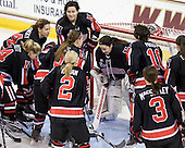 The Huskies gather around Leah Sulyma (NU - 1). - The Boston College Eagles defeated the visiting Northeastern University Huskies 2-1 on Sunday, January 30, 2011, at Conte Forum in Chestnut Hill, Massachusetts.