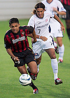 Amado Guevara of the MetroStars is chased by Jose Cancela. Guevara scored the game winning goal in the 109 minute. The New England Revolution were defeated by the NY/NJ MetroStars 2-1 during quarterfinals action of the Lamar Hunt U.S. Open Cup on 8/27/03 at Yurcak Field, Rutgers University, Piscataway, NJ..