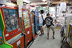 Tokyo, Japan - A kid plays with retro game machine at the Traditional Sweet Shop and Game Museum in Tokyo, June 16, 2013. The Traditional Sweet Shop and Game Museum opened in 2009 to introduce the Japanese retro sweets and games to visitors who can play with 10 yen (10 cents USD). According to the owner some machines are from 1970. The Museum also rents the machines to movies and TV programs. It received a Citizen's Culture Special Award from Itabashi Ward. (Photo by Rodrigo Reyes Marin/AFLO)