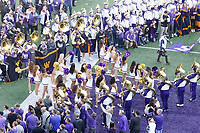 SEATTLE, WA - OCTOBER 28:  Washington cheerleaders lead the football team out onto the field before the game against UCLA on October 28, 2017 at Husky Stadium in Seattle, WA. Washington won 44-23 over UCLA.