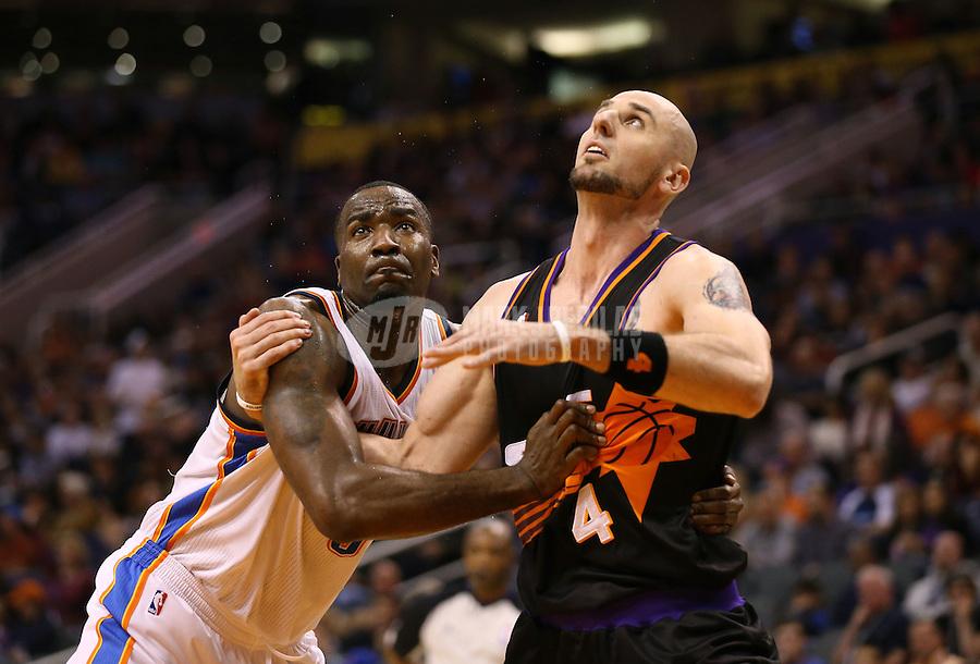 Feb. 10, 2013; Phoenix, AZ, USA: Phoenix Suns center Marcin Gortat (right) against Oklahoma City Thunder center Kendrick Perkins at the US Airways Center. Mandatory Credit: Mark J. Rebilas-