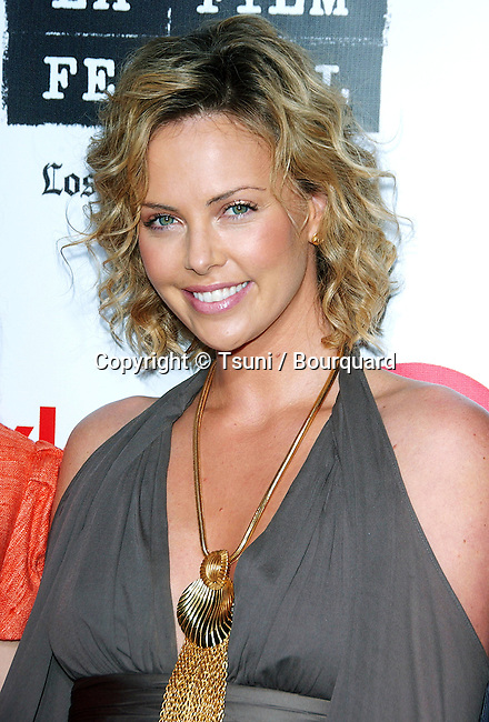 Charlize Theron arriving at the SPIRIT OF INDEPENDENCE AWARDS at the W Hotel In Los Angeles. June 28, 2006.