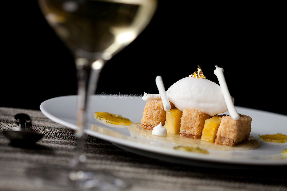 A dessert of coconut cheesecake with pineapple and sprinkled with lime zest is served at restaurant 'Flaveur', Nice, France, 10 April 2012
